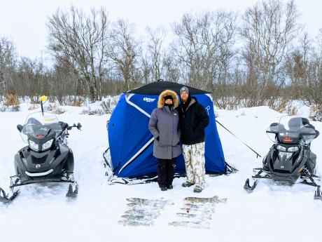 Remote Snowmobile Northern Pike Ice fishing
