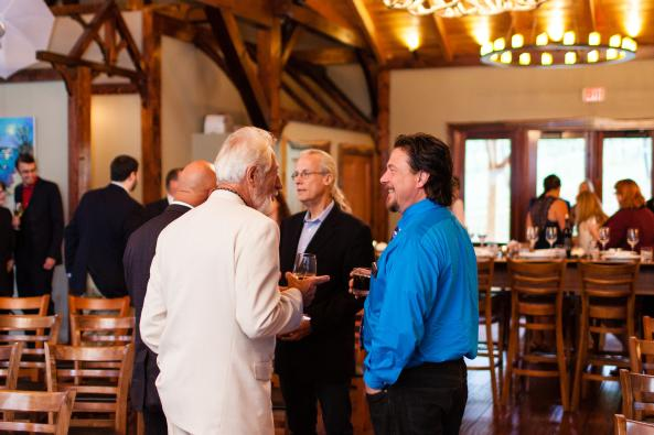 Visitors mingle in the large tasting room