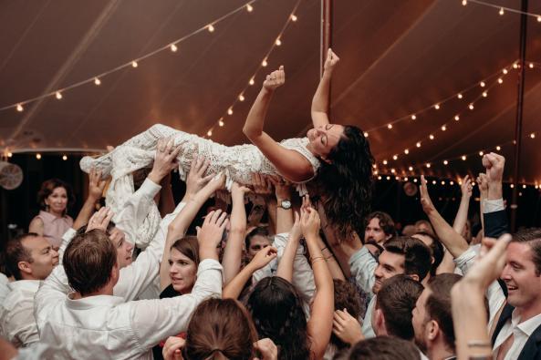 Crowd surfing reception bride