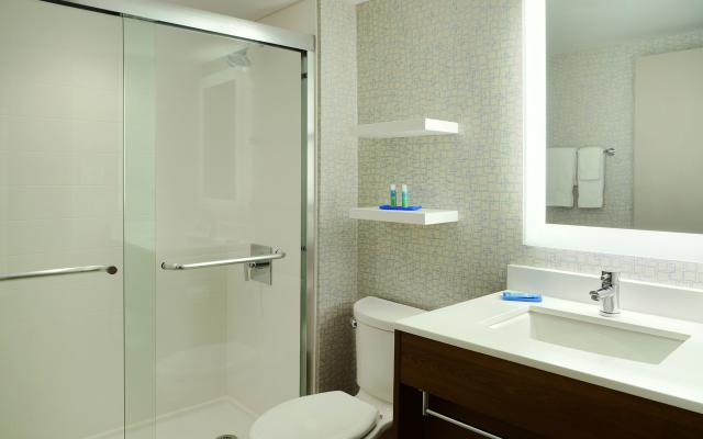 Relax in the modernized bathrooms featuring a very well lit mirror and Bath & Body works products
