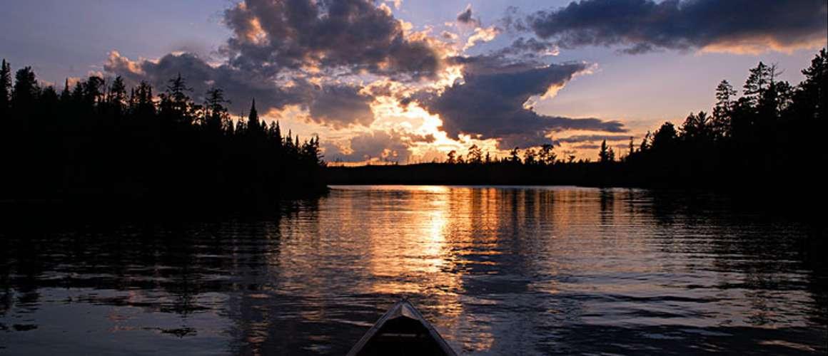 Blue canoe at sunset