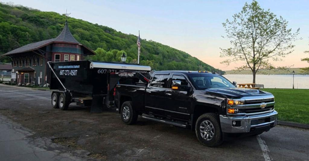 Finger Lakes Dumpster Company - Truck Towing Dumpster