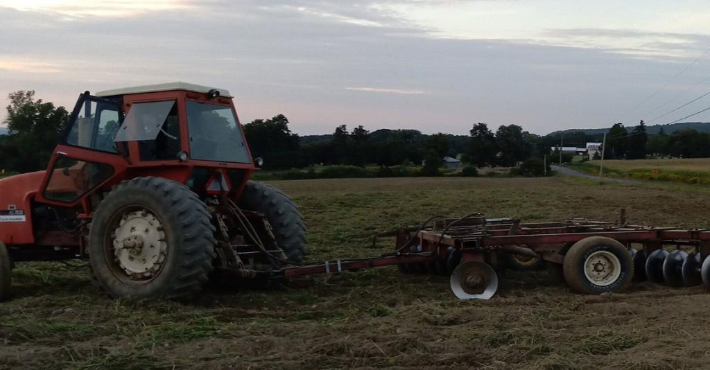 Finger Lakes Tractor Service - Tractor in Field