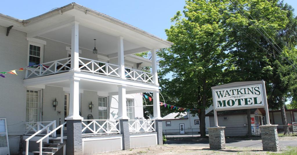 Watkins Motel - Building Exterior with Sign