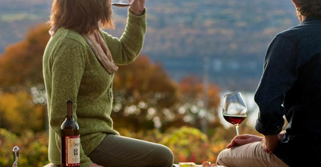Couple enjoying wine.