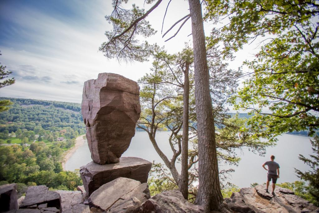 Man-Next-to-Balanced-Rock-at-Devils-Lake-large