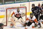 Rochester Institute of Technology hockey goalie defends the goal at championship game