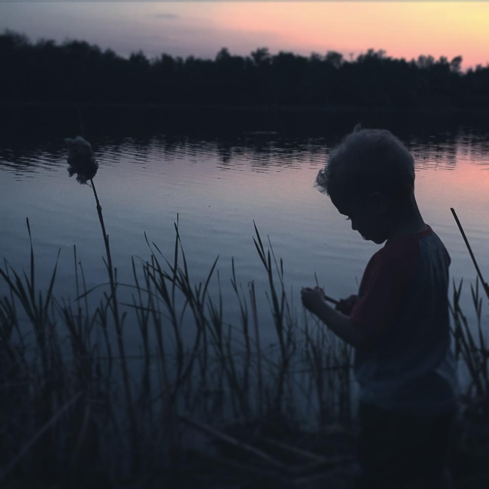 Child at sunset at Lake Metigoshe