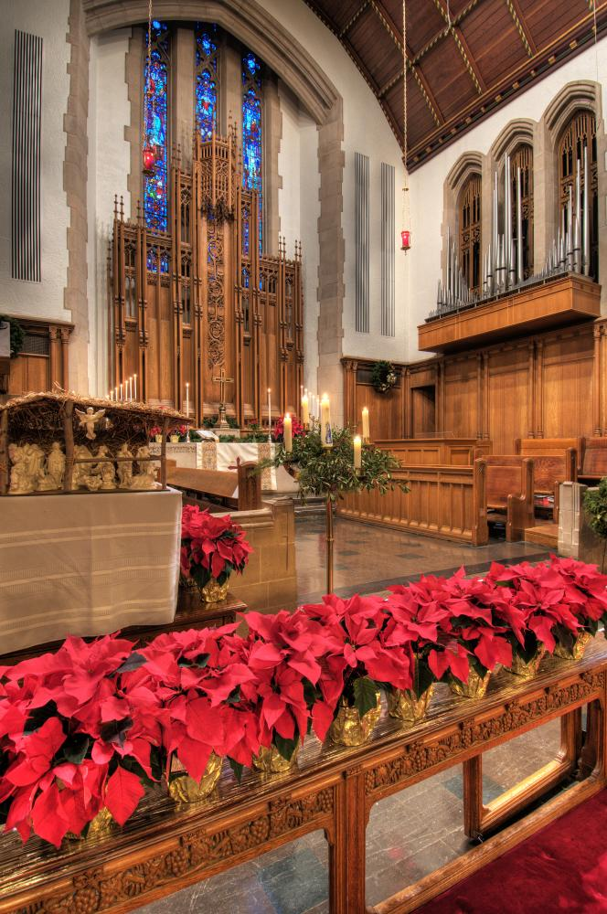 Church Chapel with candles and poinsettias at the Historic Houses of Worship