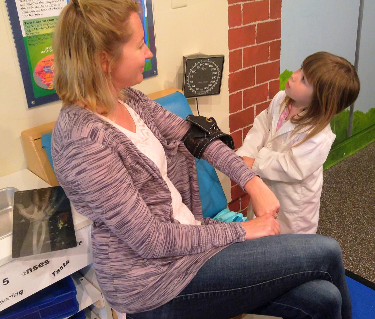 "Child ""taking patient's blood pressure"" in Bucks County Children's Museum"