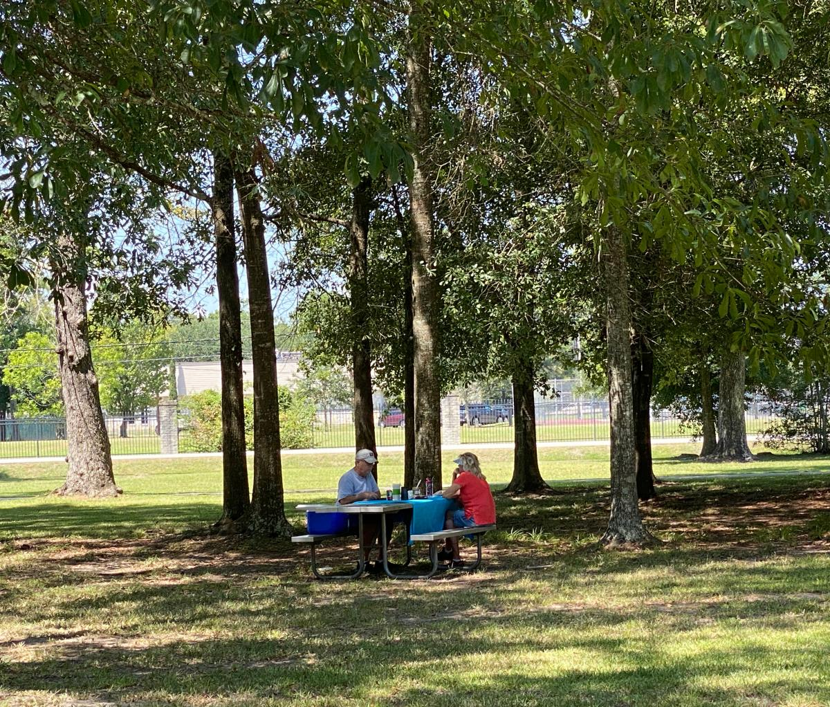 A couple enjoys a leisurely picnic in the shade at Wuthering Heights Park.