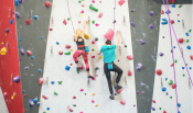A couple climb a wall together at Bliss Climbing and Fitness in Wichita