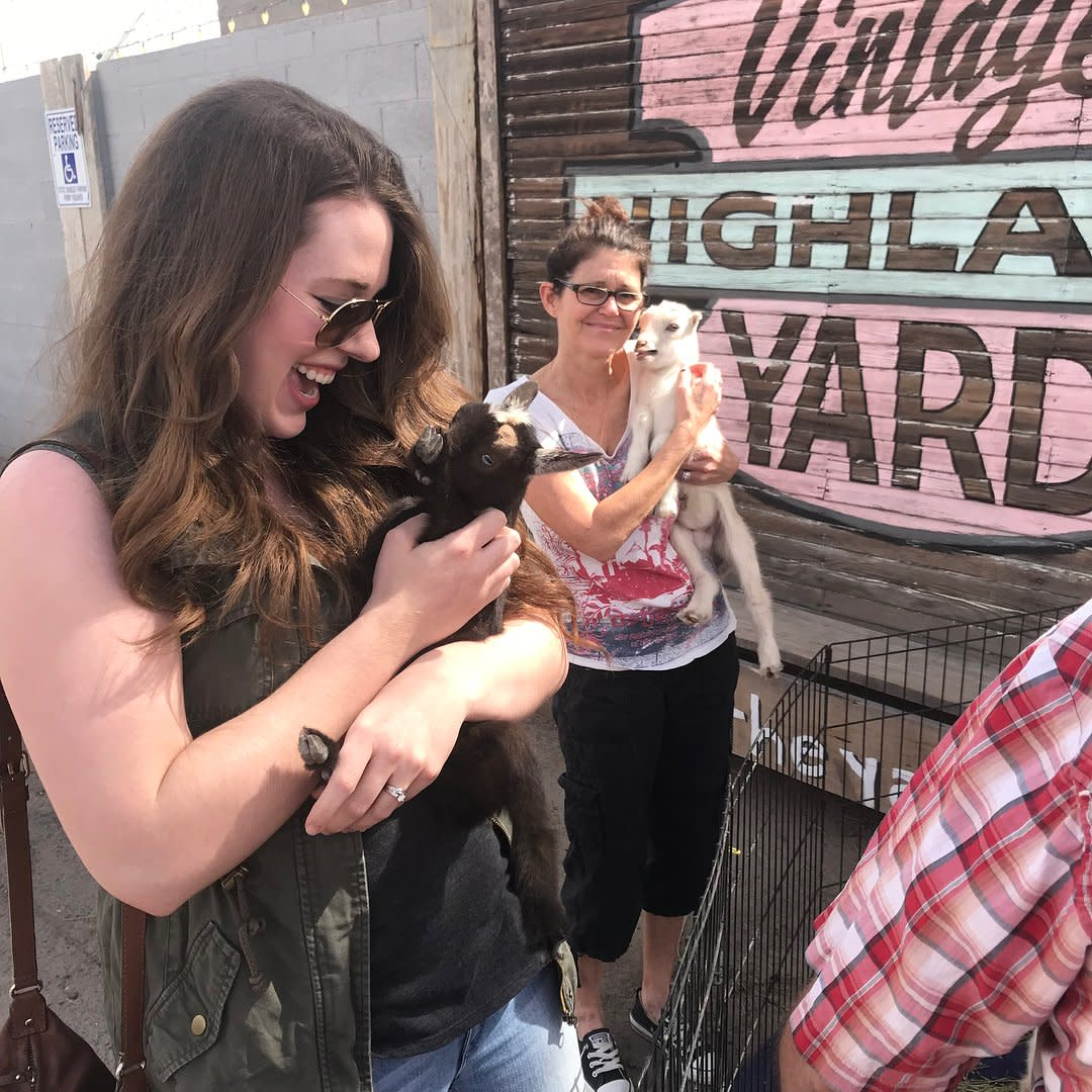 Women hold baby goats at Highland Yard Vintage Market in Chandler, AZ