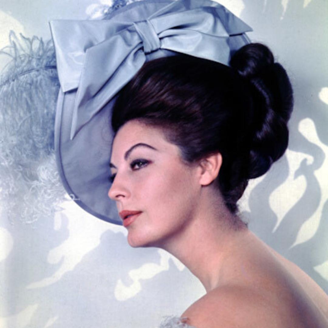 Ava Gardner wearing large blue hat.