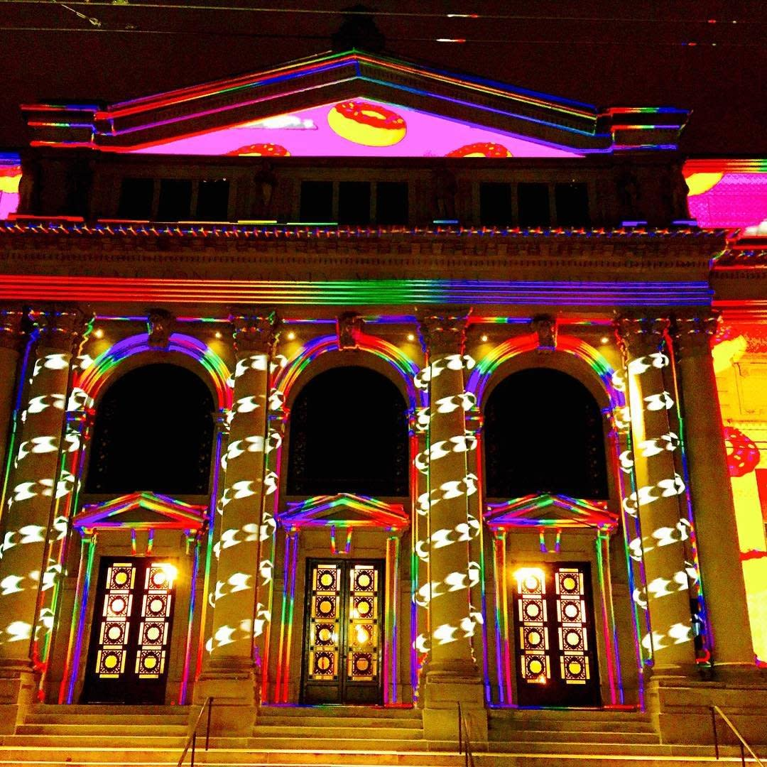 A building in Cincinnati covered in elaborate light displays for BLINK