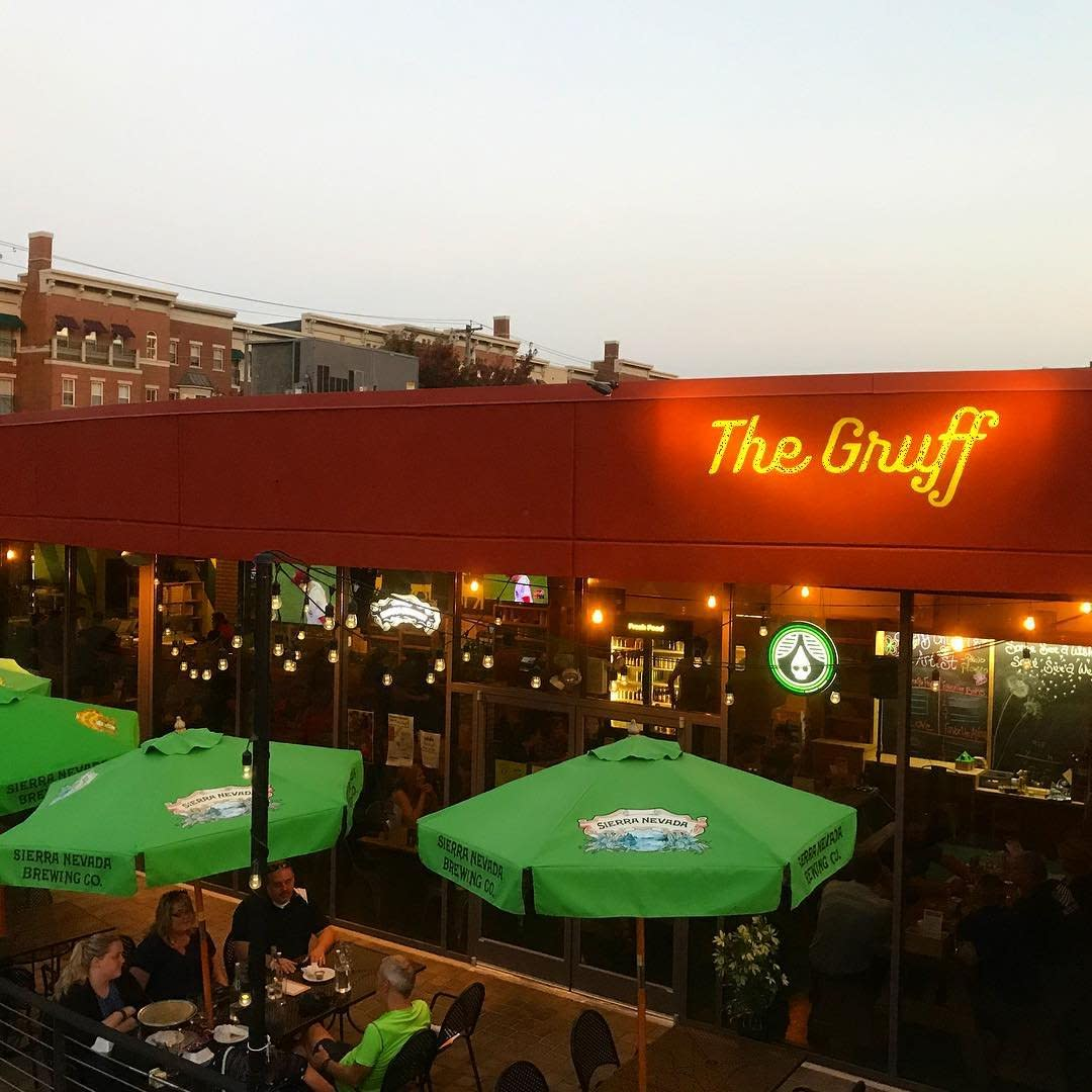 The Gruff restaurant and patio with green umbrellas in Covington, KY