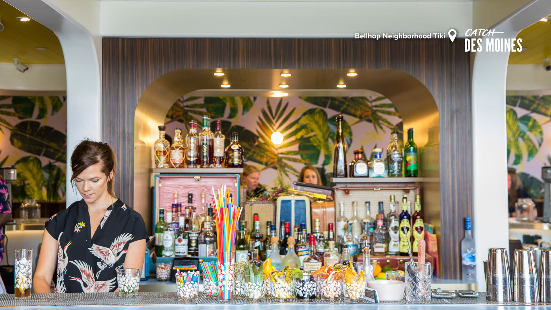 Bartender with Top Shelf Alcohol at Bellhop Tiki Zoom Background