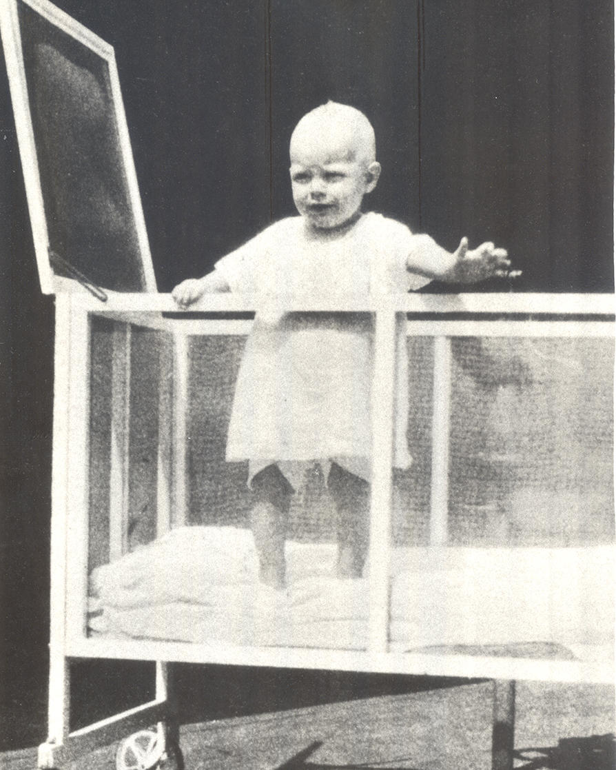 Ava Gardner age 1 in crib known as a Kiddie Coup.