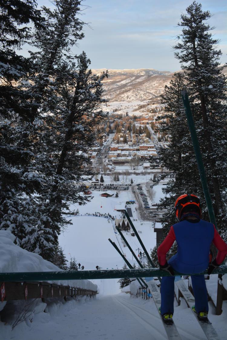 A ski jumper prepares to jump at Historic Howelsen Hill