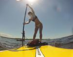 SUP Sackets Harbor co-owner Jamie McGiver, on a paddleboard, is a World Paddle Association Stand Up Paddleboard on-board yoga instructor. Photo: SUP Sackets Harbor