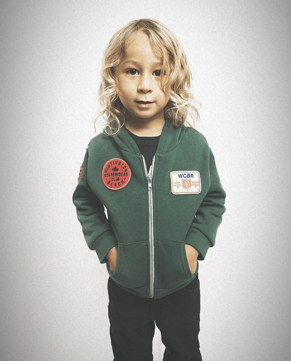 Young child wearing Sport of Kings Forever Young Surf Brand