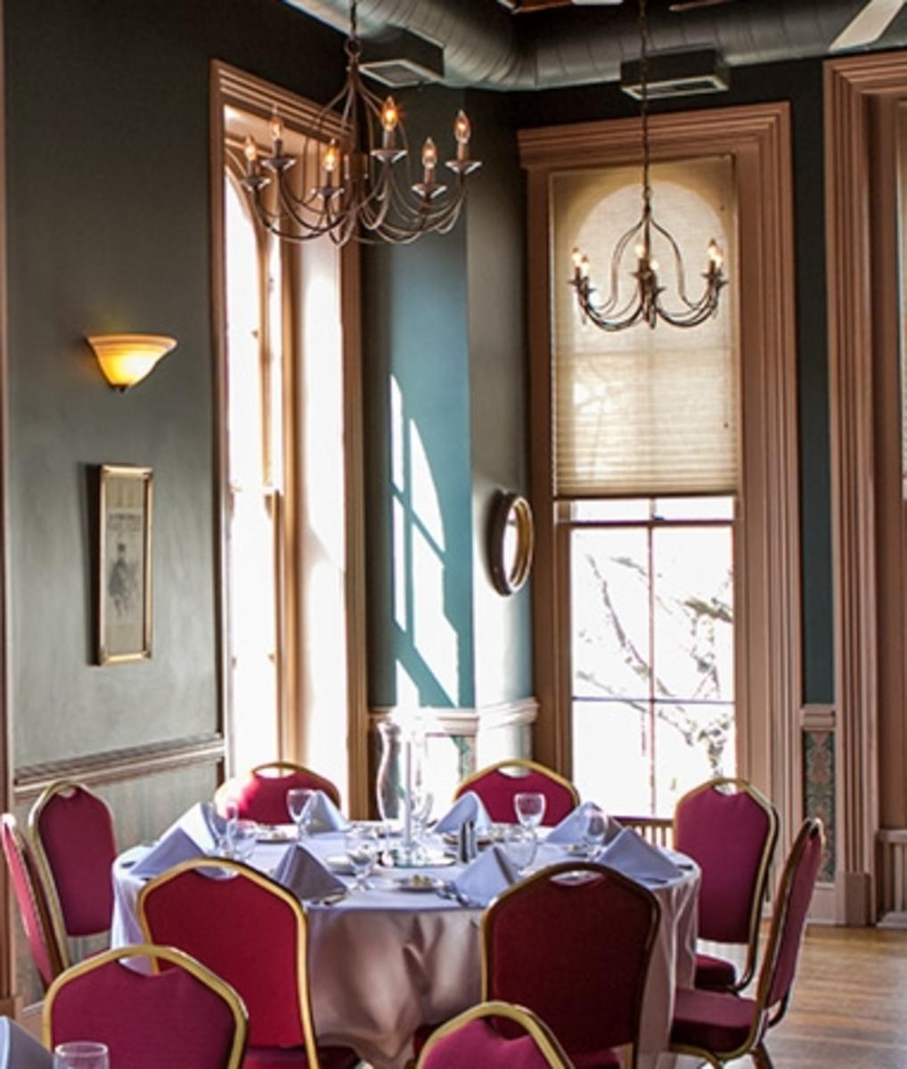 Ballroom decorated with tables and chairs at Brewer's Alley Private Room
