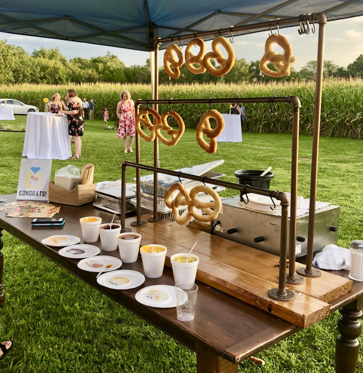 Pretzel Bar Station set up in an outside tent at a Frederick wedding