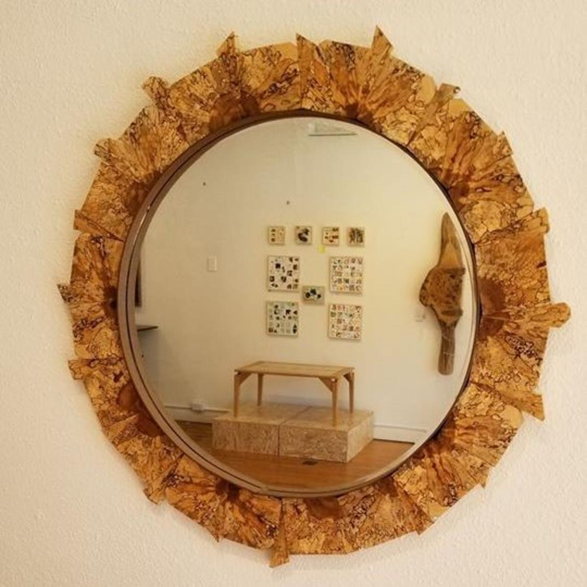 A mirror created by Gallery Q artist, Graham Coulson.