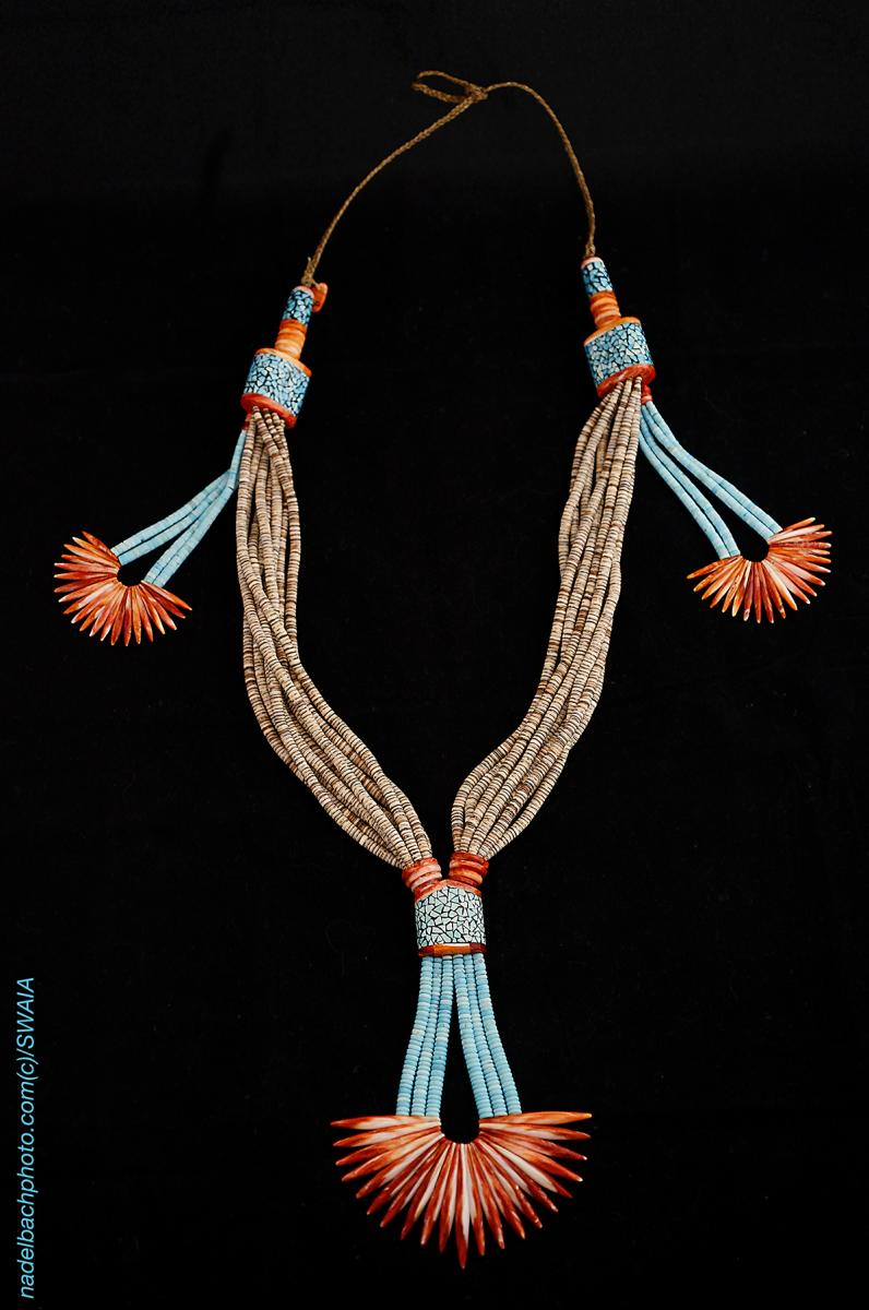 Farrell Pacheco worked on the necklace in their Kewa (Santo Domingo) Pueblo jewelry studio