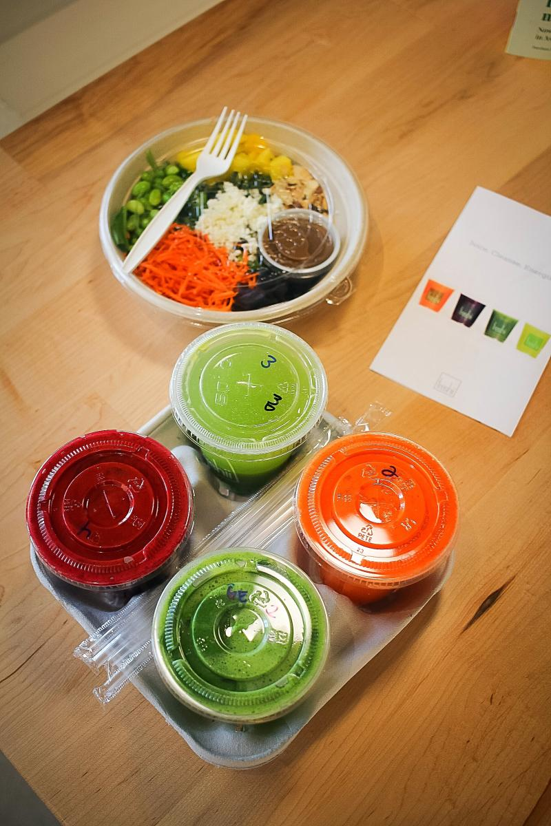 Freshii Metaboost Salad to-go and carrying tray with juice cleanses