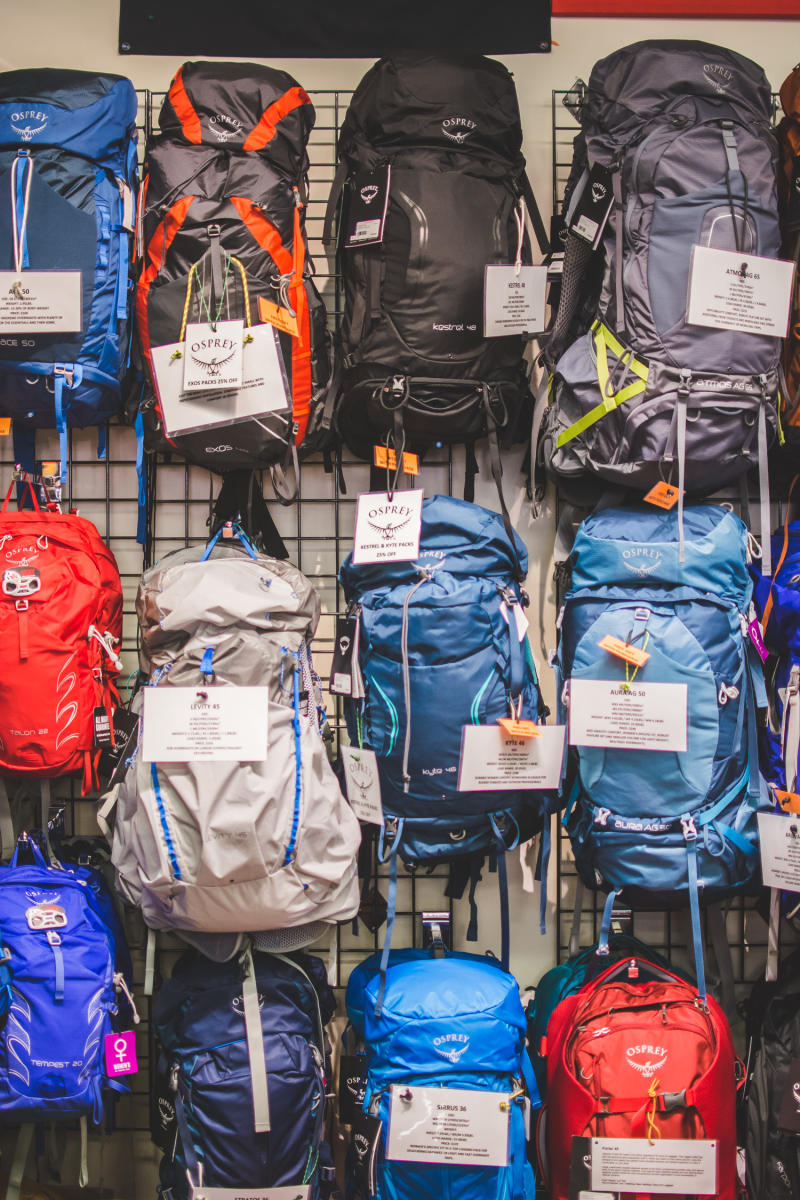 The Trail House wall of backpacks