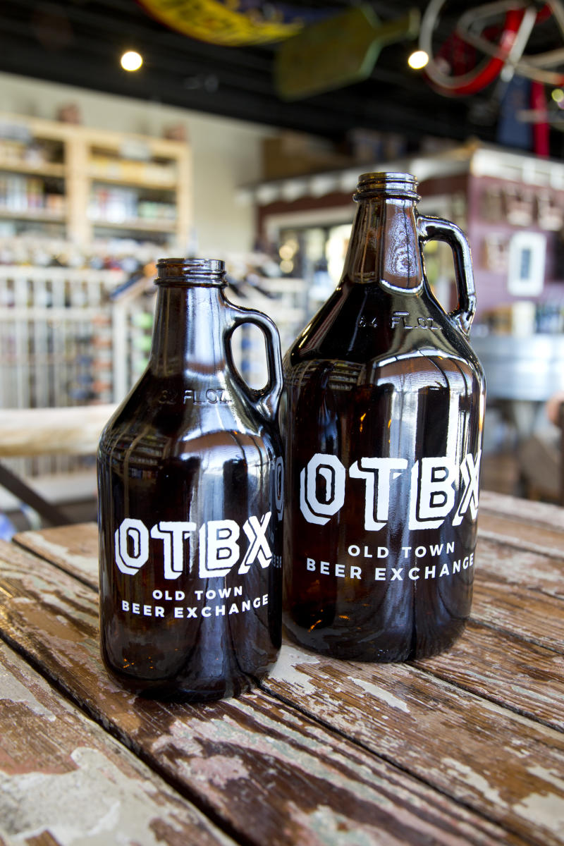 2 beer growlers from Old Town Beer Exchange in Huntsville, AL