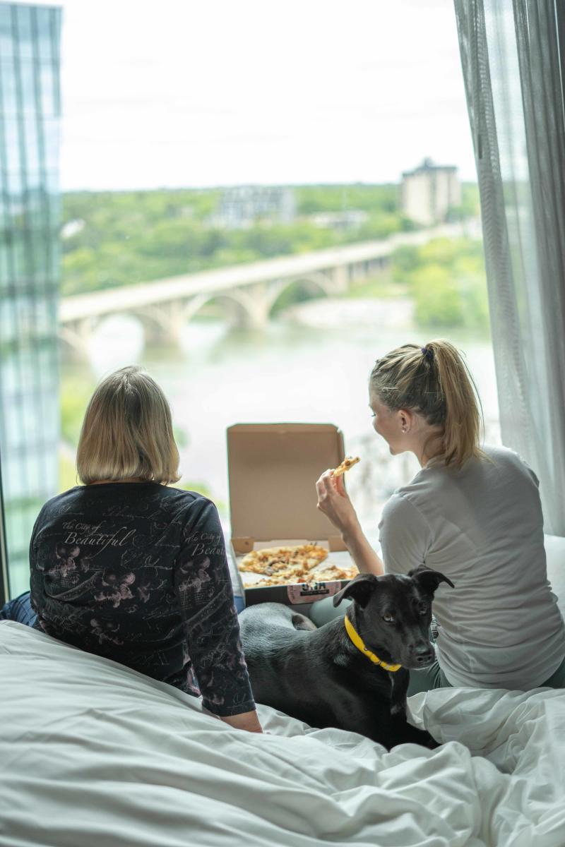 Two Women Eating Una Pizza in Saskatoon