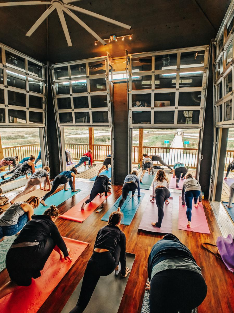 A group yoga class at Cattail Marsh Wetlands Education Center