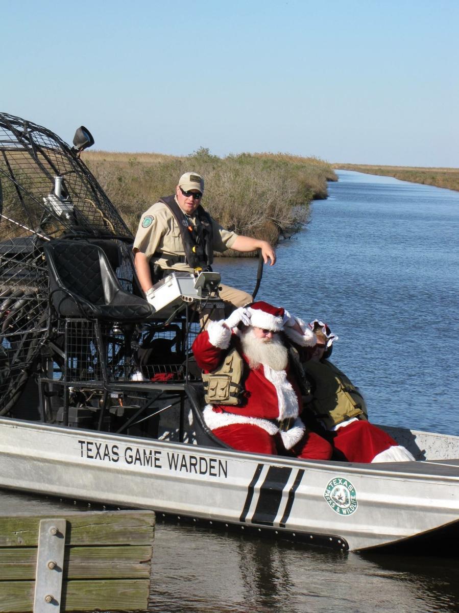 Santa rides an air boat in Port Arthur, TX