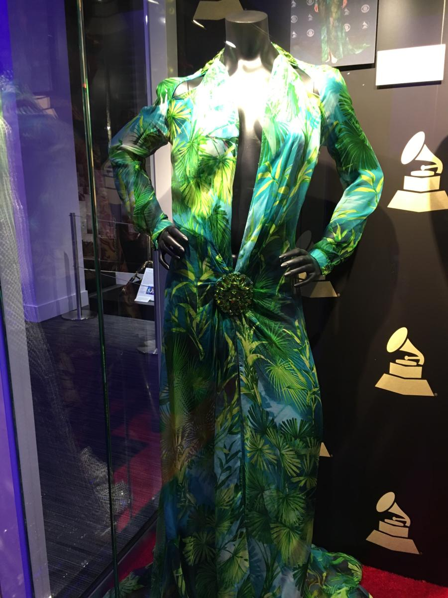 A dress worn by Jennifer Lopez with a plunging neckline on display at the GRAMMY Museum Experience in Newark, NJ