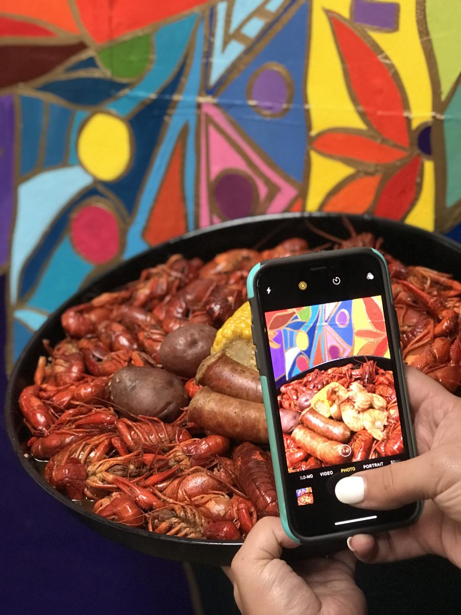 Phone taking a picture of a Beaumont crawfish dish