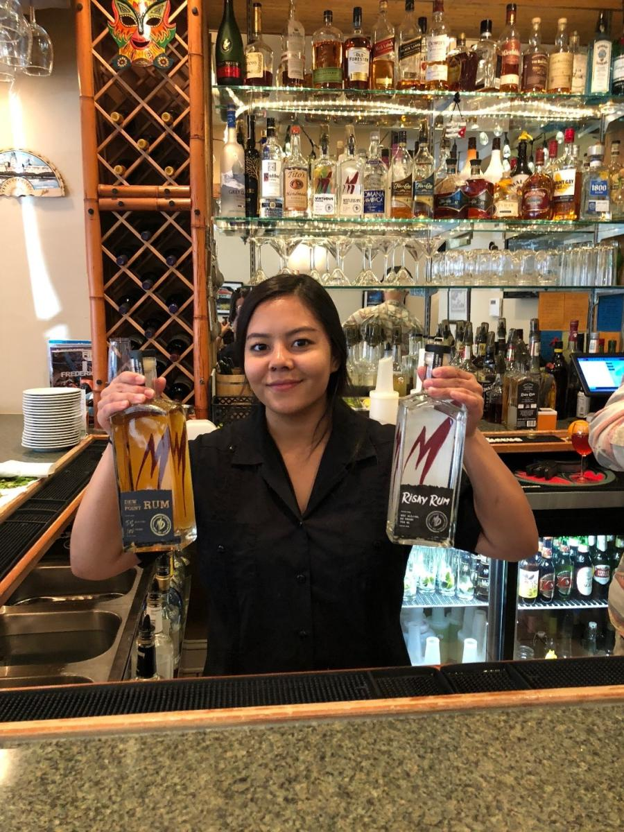 Sabor de Cuba! bartender holding bottles of rum