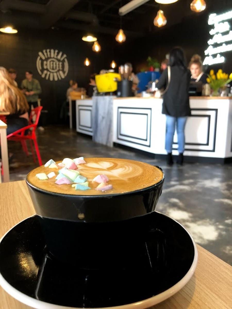 Rainbow marshmallows float in the foam of a fresh cup from Offbeat Coffee.
