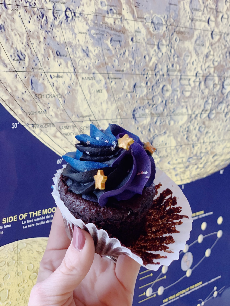 A visitor shows off their star-topped Vegan Mason Dixon Cupcake.