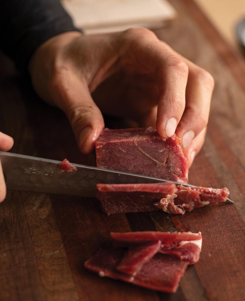 Ortiz preparing elk meat.