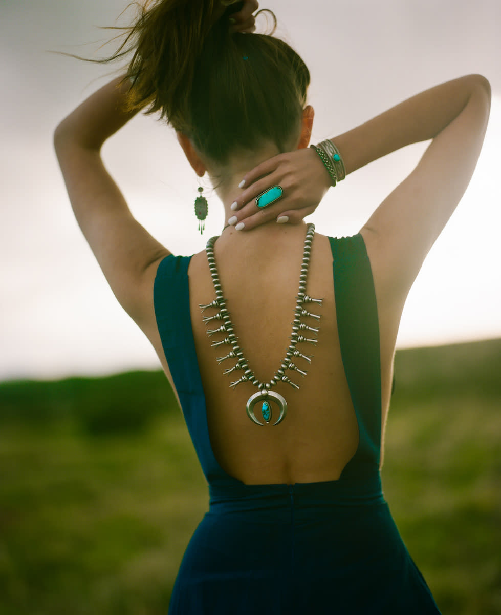 Jewelry model wearing squash blossom