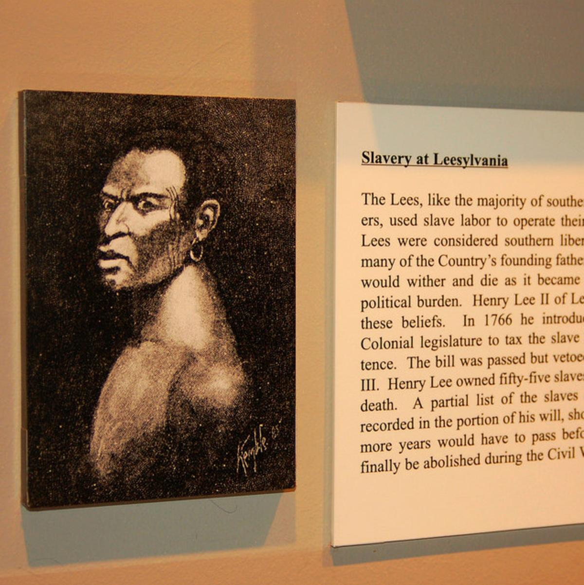 drawing of a representation of a slave alongside text explaining the history of slavery at Leesylvania