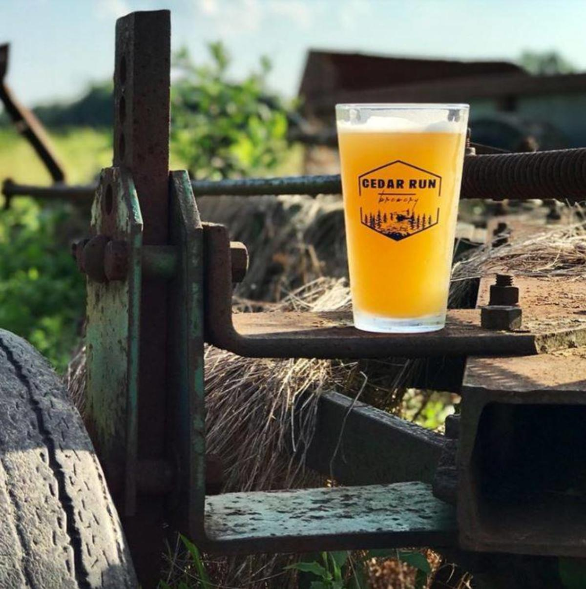 Cedar Run Brewery - full beer glass sitting on farm equipment