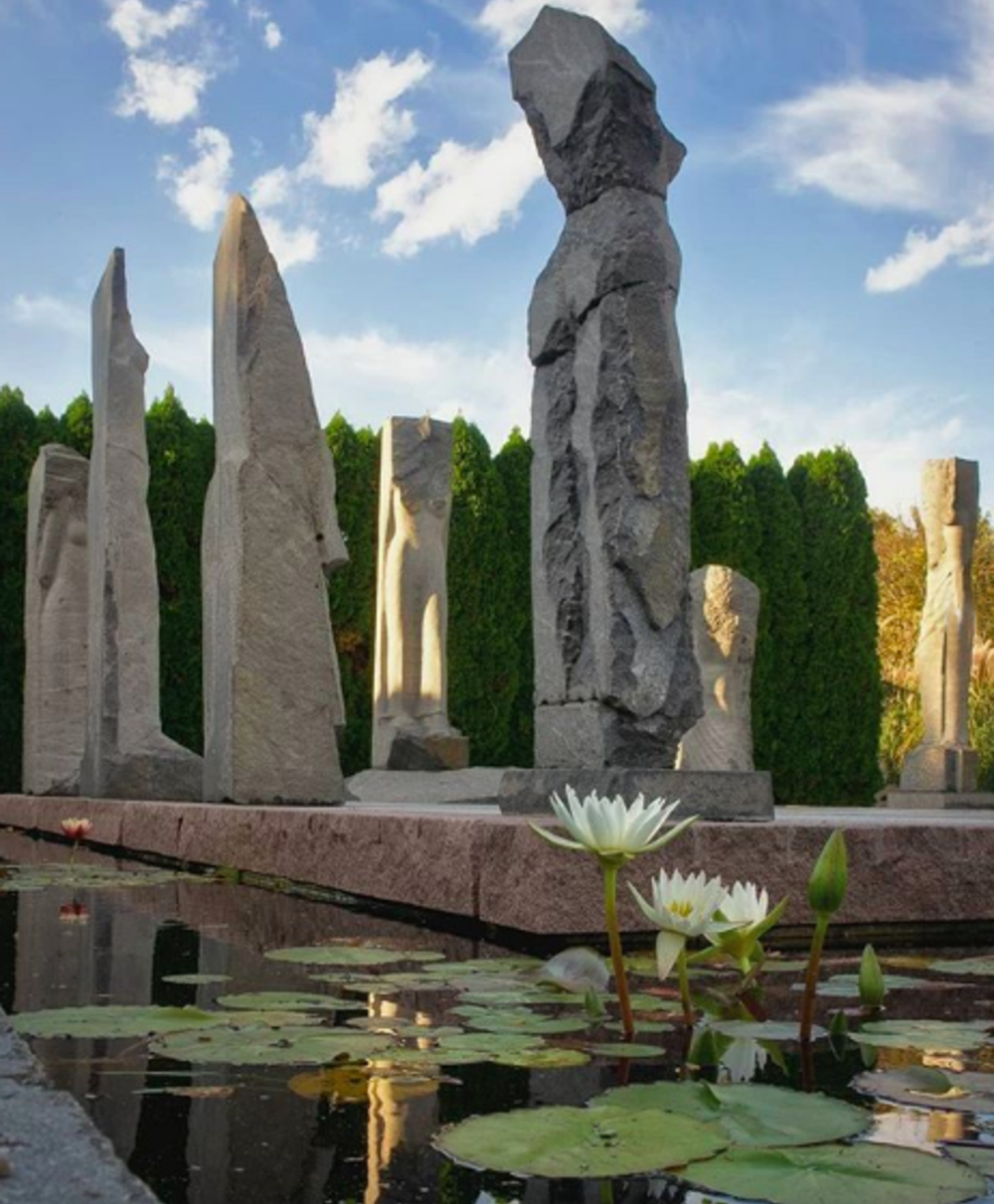 A pond with large monolithic sculptures at the center