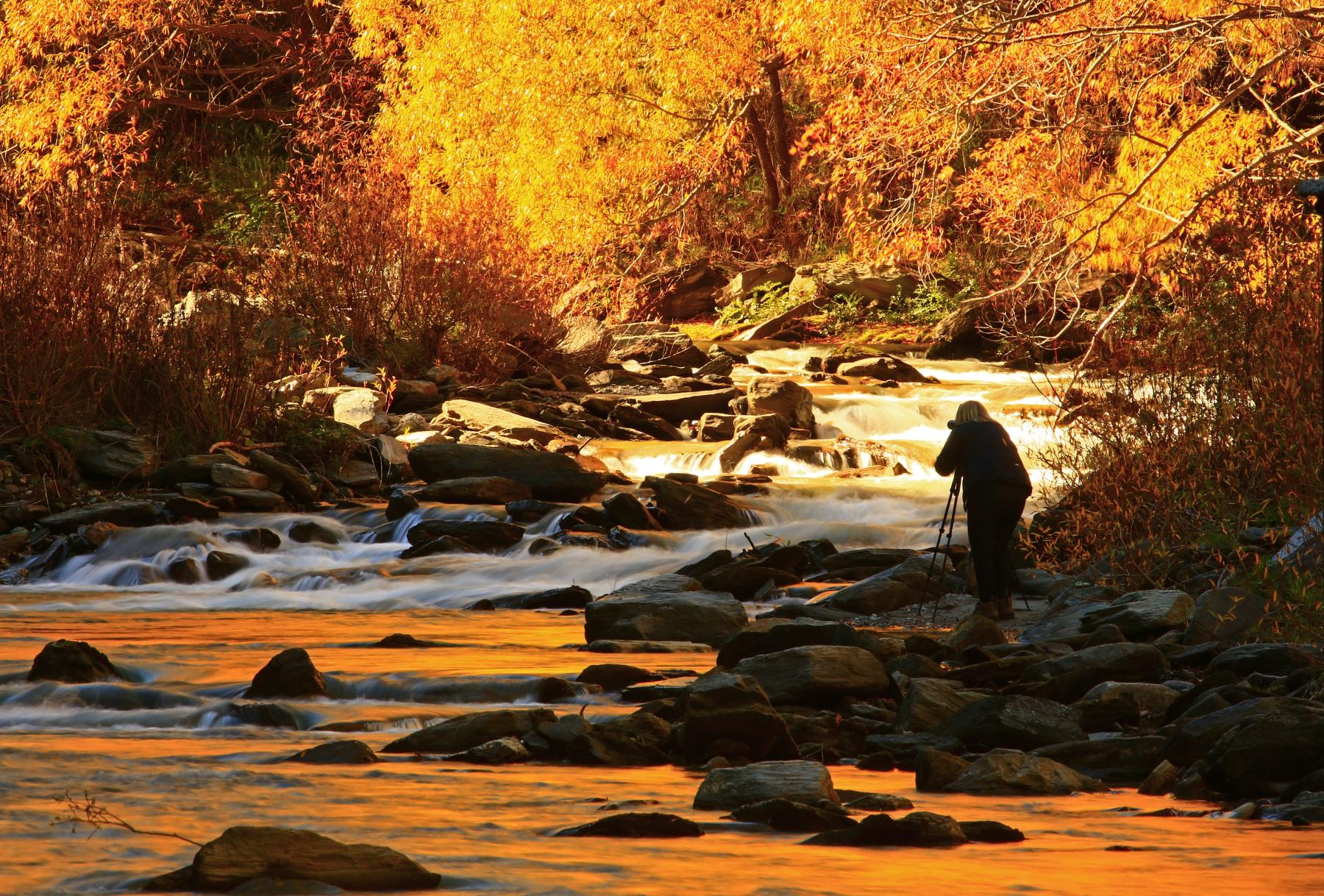 Photographer shooting the Arrow River in Autumn