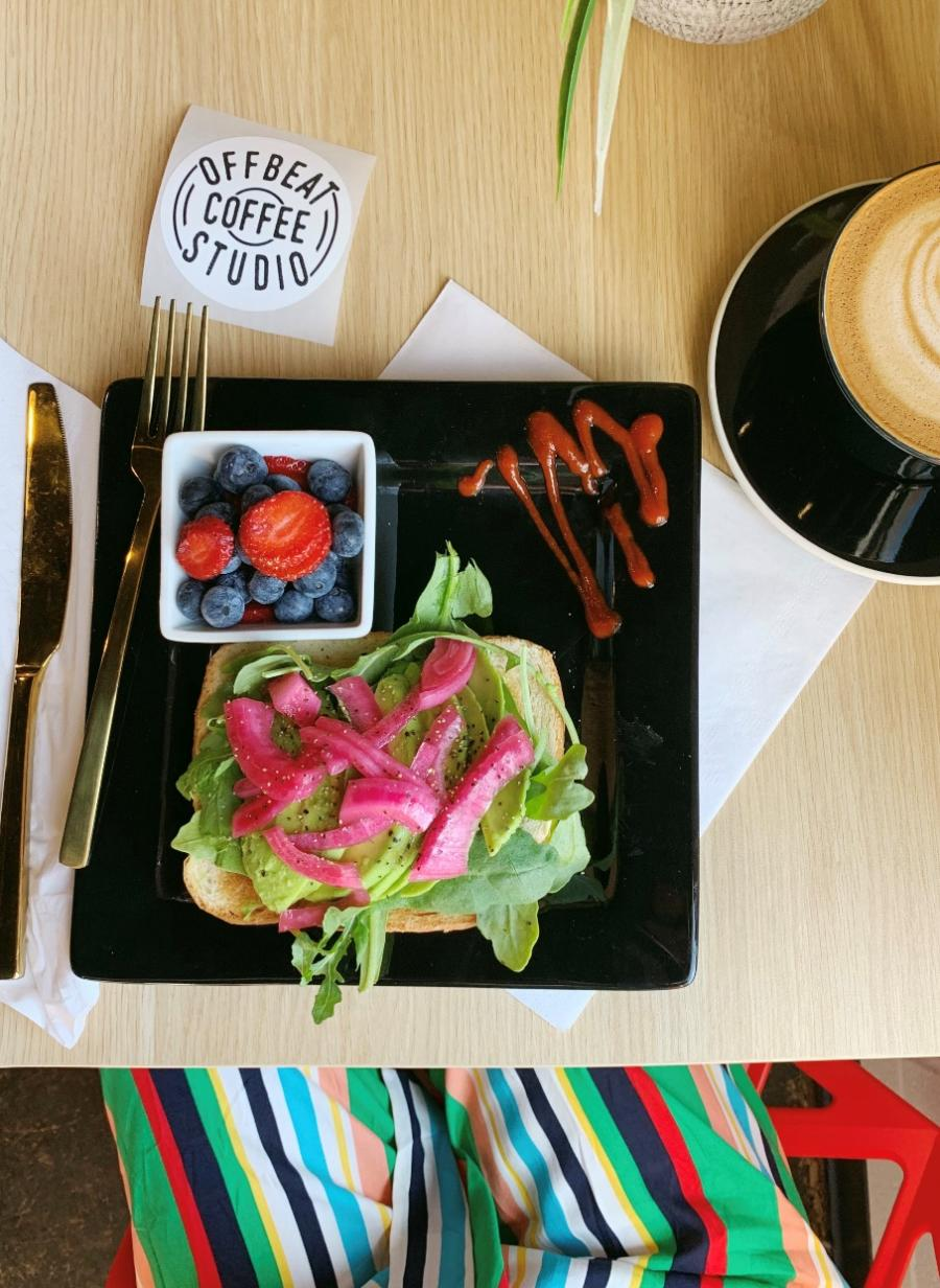 Avocado Toast with Fresh Fruit at Offbeat Coffee Studio