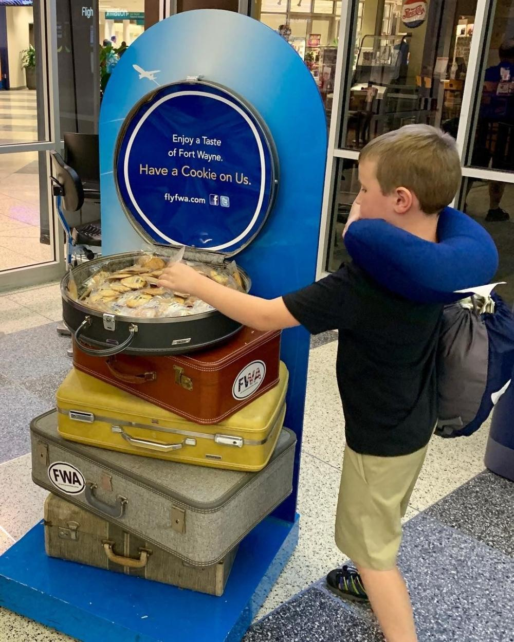 Child picking out a complimentary cookie at the Fort Wayne International Airport