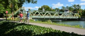 Cycling visitors at the Adams Basin lift bridge on the Erie Canal