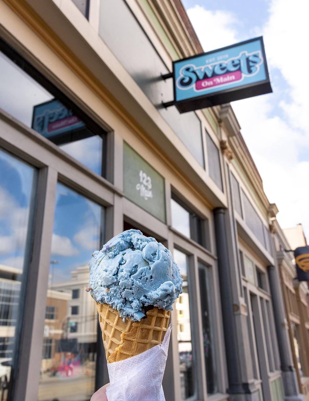 Birthday cake flavored ice cream in a waffle cone at Sweets on Main in downtown Fort Wayne
